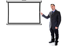 Pointing to blank projection screen. man in suit. Man in suit pointing to blank projection screen Royalty Free Stock Photo