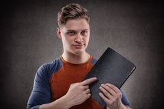 Pointing to the book Stock Image