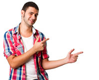 Pointing to copyspace. Young hispanic man pointing to blank copyspace Stock Images
