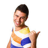 Pointing to copyspace. Young hispanic man pointing to blank copyspace Stock Photography