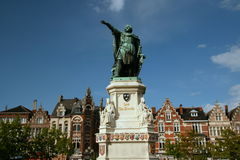 Pointing to history. Statue in Ghent, Belgium with historic houses in the background Royalty Free Stock Images