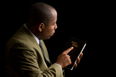 Pointing to the Holy Bible as the Answer Royalty Free Stock Photography