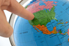 Pointing to a place in the world Stock Images