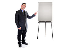 Pointing to presentation easel. man in suit Stock Image
