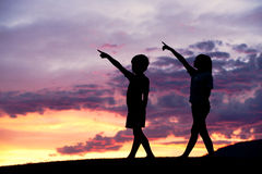 Pointing to the sky at sunset. Stock Photos
