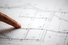 Pointing to specific place on architectural sketches Royalty Free Stock Photos