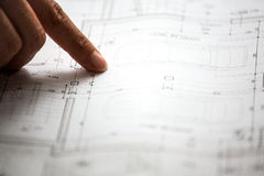 Pointing to specific place on architectural sketches Royalty Free Stock Photo