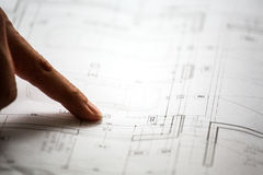 Pointing to specific place on architectural sketches Royalty Free Stock Image