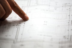 Pointing to specific place on architectural sketches Stock Photography
