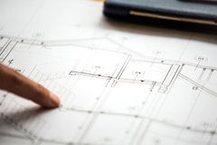 Pointing to specific place on architectural sketches Royalty Free Stock Photography