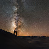 Pointing to the Stars. A couple stargazing in Great Sand Dunes National Park Stock Photography