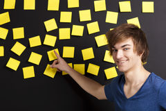 Pointing to a yellow note Stock Images