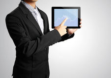 Pointing on touch screen tablet in hand Stock Photography