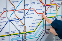 Pointing at a Tube map Royalty Free Stock Images