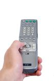 Pointing the TV Remote control. A hand holding the TV controller Stock Image