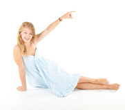 Pointing up beautiful girl in blue dress Royalty Free Stock Images