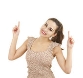 Pointing up casual young woman Stock Image