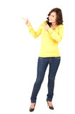 Pointing up smiling teenage woman Stock Image
