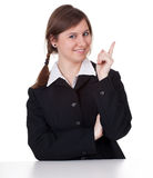 Pointing up smiling young businesswoman Royalty Free Stock Image