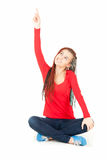 Pointing up teenage girl in african plaits Royalty Free Stock Images