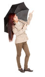 Pointing up woman with black umbrella Stock Image