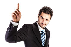 Pointing up. A young and handsome businessman pointing up with his finger Stock Photography