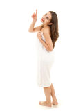 Pointing up young woman in towel Stock Photos