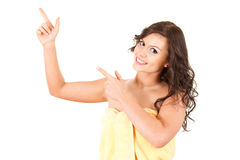Pointing up young woman in towel Stock Image