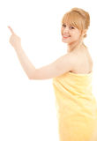 Pointing up young woman in towel Royalty Free Stock Photo