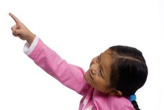 Pointing upward. A young girl points upward at something Royalty Free Stock Images