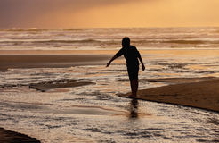 Pointing at the water at sunset. Royalty Free Stock Photos