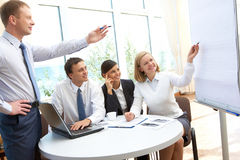 Pointing at whiteboard Royalty Free Stock Image