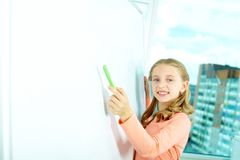 Pointing at whiteboard Royalty Free Stock Photo