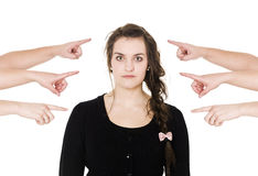Pointing at a woman. Group of Hands pointing at a woman on white background Royalty Free Stock Image