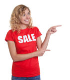 Pointing woman with blond hair in a sale shirt Stock Photos