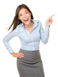 Pointing woman cheerful excited. Pointing woman excited, happy and cheerful showing empty copy space with room for product, text etc. mixed race Asian Caucasian Stock Photos