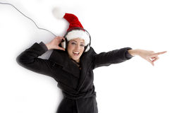 Pointing woman with christmas hat Stock Photo