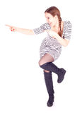 Pointing woman in dress pointing Royalty Free Stock Images