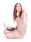 Pointing woman with laptop Stock Image