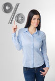 Pointing woman. Portrait of young business woman pointing to percent sign Stock Photography