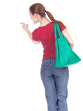 Pointing woman with shopping bag Stock Photo