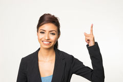 Pointing woman smiling Stock Images