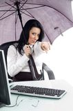 Pointing woman with umbrella and computer Royalty Free Stock Photography