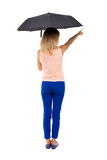 Pointing  woman  under an umbrella Royalty Free Stock Image