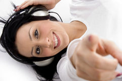 Pointing woman wearing  headphones Royalty Free Stock Images