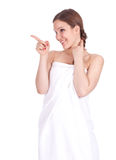 Pointing woman in white towel Stock Image