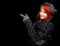 Pointing woman in winter clothes Stock Photo