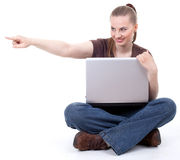 Pointing woman working on laptop Royalty Free Stock Photo