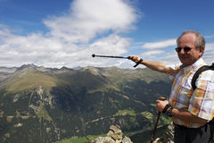 Pointing at wonderful landscape in the Alps Royalty Free Stock Images