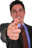 Pointing at you. Businessman pointing his finger at you Royalty Free Stock Images